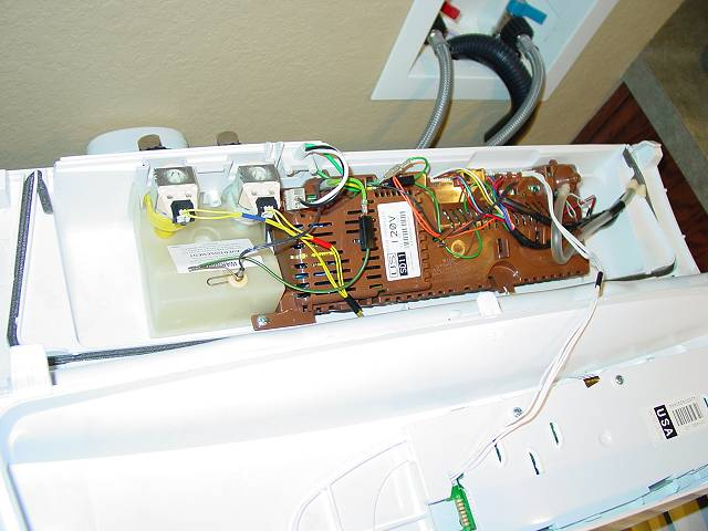 small leak drip fisher paykel gwl11 washer pictures cold is the left valve the yellow body the little wired device at front of the mixing chamber is the thermistor to sense water temperature